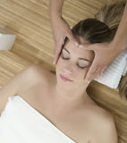Massage therapy. Woman in a day spa getting a deep tissue massage therapy Stock Photo