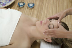 Massage therapy. Woman in a day spa getting a deep tissue massage therapy Royalty Free Stock Photography