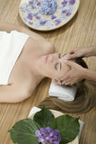 Massage therapy. Woman in a day spa getting a deep tissue massage therapy Stock Photos