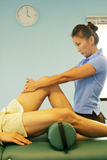 Massage therapy - leg massage Stock Photography