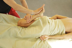 Massage therapy - leg massage Royalty Free Stock Images