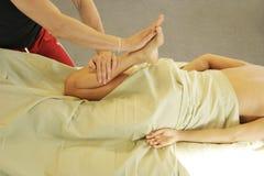 Massage therapy - leg massage Royalty Free Stock Images