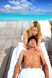 Massage therapy stretch head neck outdoor. Caribbean beach Stock Photography