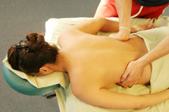Massage therapy - therapist giving back massage Royalty Free Stock Photography