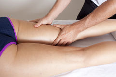 Massage of thigh Royalty Free Stock Photos