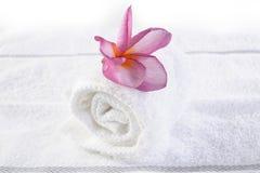 Massage towel with plumeria Royalty Free Stock Photo