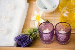 Massage tray with candles and oil Royalty Free Stock Images