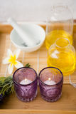 Massage tray with candles and oil Stock Images