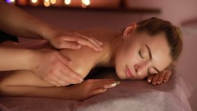 Massage treatment procedure in beauty salon. Wellness, skin care.