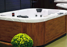 Massage Bath Tub. Hydro hot massage bath tub with wooden structure stock photo