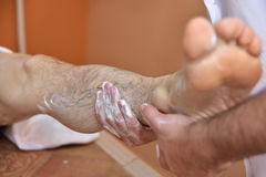Massage with volcanic stones and hands Stock Photo