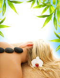 Massage wit volcanic stones Stock Photography