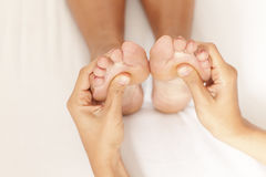 Massage of a woman's foot Royalty Free Stock Image