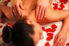 Massage a woman Royalty Free Stock Images