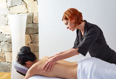 Massage in woman back with physiotherapist Royalty Free Stock Photo