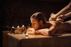 Massage. Woman with herbal compress massage in beauty spa Royalty Free Stock Photography