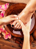 Massage of woman's foot in spa salon Stock Images