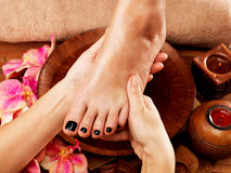 Massage of woman's foot in spa salon. Beauty treatment concept Stock Photography