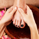 Massage of woman's foot in spa salon Stock Photography