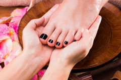 Massage of woman's foot in spa salon Royalty Free Stock Photography