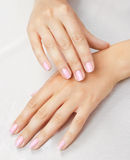 Massage of woman's hands. Massage of woman's hand on the white tablecloth Stock Photo