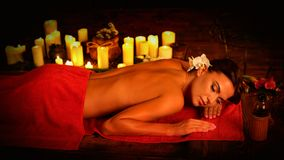 Massage of woman in spa salon. Luxary interior oriental therapy . royalty free stock photography