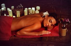Massage of woman in spa salon. Luxary interior oriental therapy. stock photography