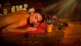 Massage of woman in spa salon. Luxary interior oriental therapy . Stock Images