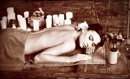 Massage of woman in spa salon. Luxary interior oriental therapy . stock photo