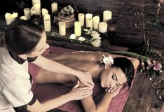 Massage of woman in spa salon. Luxary interior oriental therapy. royalty free stock images