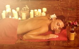 Massage of woman in spa salon. Luxary interior oriental therapy . stock image