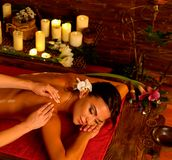 Massage of woman in spa salon. Luxary interior oriental therapy. Stock Image