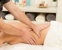 Massage on a woman at spa salon Stock Photography