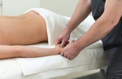 Massage on a woman at spa salon Stock Image