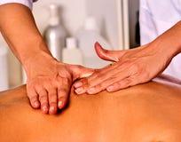 Massage woman therapist making manual therapy back. Stock Photos