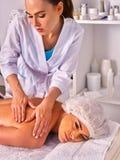 Massage woman therapist making manual therapy back. Stock Photography