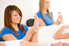 Massage: Woman Works on Hand Massage. Series of a young couple getting massages by therapists.  Together, as well as separate.  Bright and clean Stock Images