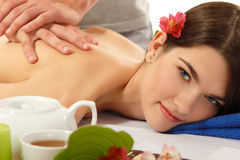 Massage woman young beautiful cheerful  on white Royalty Free Stock Photos