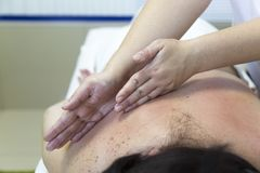 Massage women`s shoulders and waist. stock images