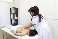 Massage women`s shoulders and waist stock images