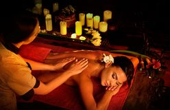Massage of woman in spa salon. Luxary interior oriental therapy. Stock Images