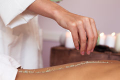 Massage. Young beautiful woman in spa Stock Photos