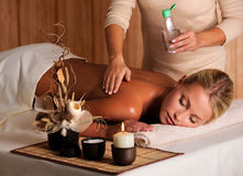 Massage for young beauty woman Stock Photos