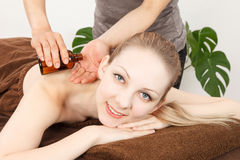 Massage a young woman Royalty Free Stock Photo