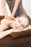 Massage a young woman Stock Image
