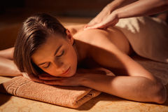 Massage. Young woman at spa massage royalty free stock photography