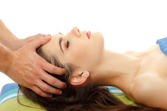 Massage young woman young  on white Royalty Free Stock Image
