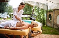 Massage - woman receiving back massage at salon spa royalty free stock image