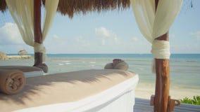A massagem apresenta a praia vídeos de arquivo