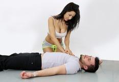 Massagem cardíaca 'sexy' imagens de stock
